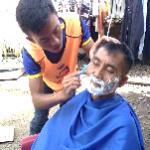 Barber in refugee camp
