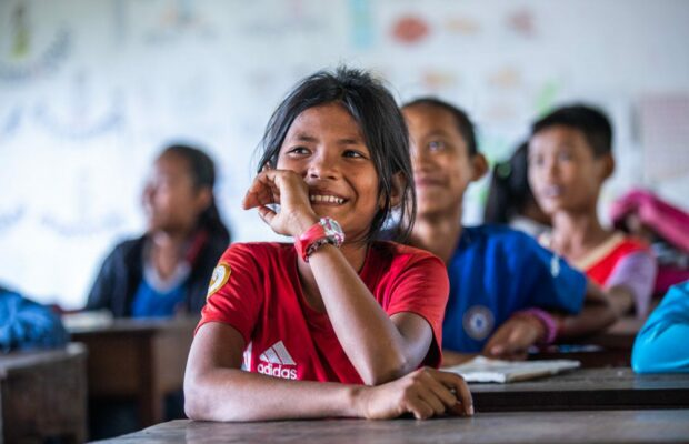 Smiling girl in classroom