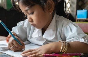 A sponsored child writing a letter