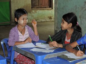 Writing a letter to a sponsored child