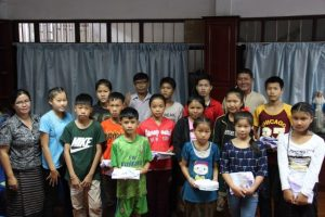 Linthy amongst the sponsored children