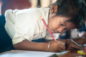 ril writing a letter, sponsor a child
