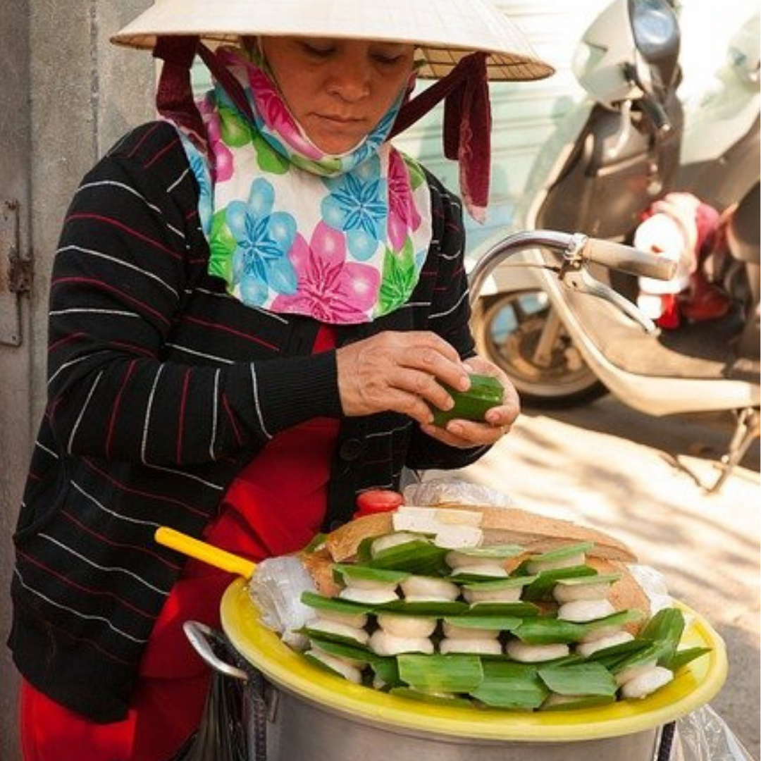 A Vietnamese woman preparing rice cakes for New Year