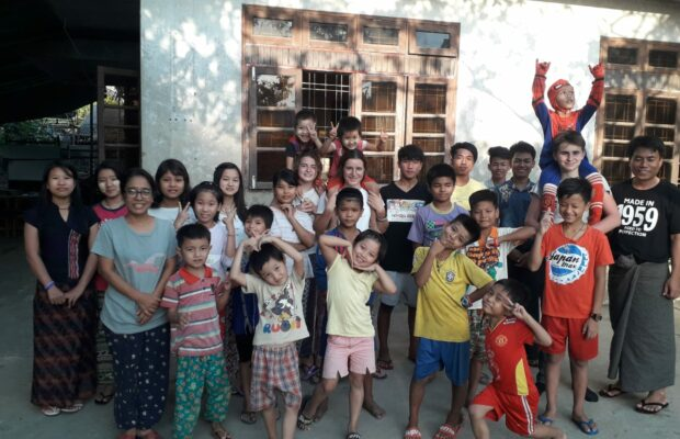 In Myanmar, an extra large family depends on donations to support 30 orphans