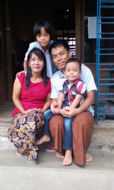 In one of Burma's Rangoon suburbs, Sainu is mother to an unusual family of 32 children, 30 of whom are adopted