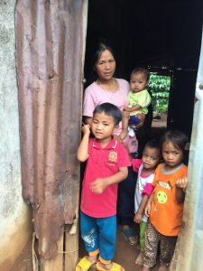 A Vietnamese family receiving food aid