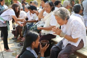 Here, grandchildren are bathing their grandparents for the Khmer new year