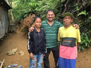 Gil Nino with a family from the slums of Cebu City
