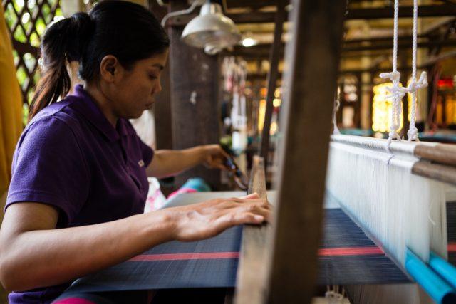 A woman silk weaving in Cambodia