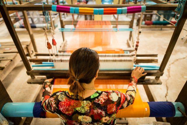 At a silk loom in Cambodia