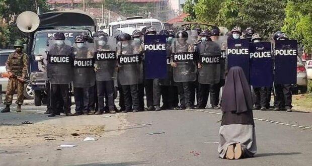 None kneeling in front of police Myanmar
