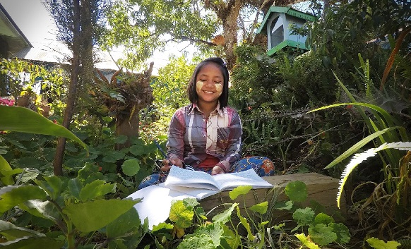 Girl studying in her boarding house in the Chin Hills