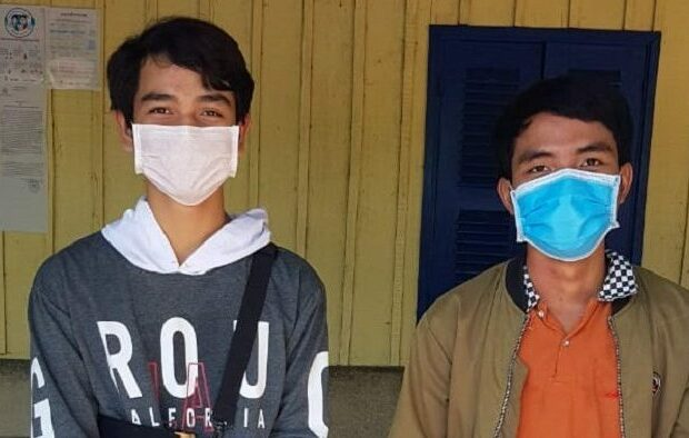 photo of two cambodian male students