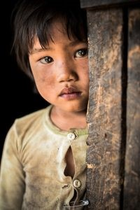 scruffy Asian child in the Kengtung region, in eastern Burma looking at the camera