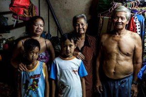 Vietnamese family looking at the camera