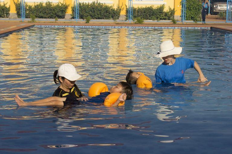 children swimming in vietnam