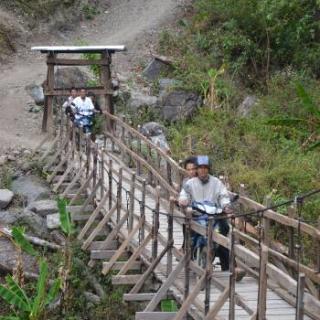 chin region. bridge. Asia. man on a motor cycle