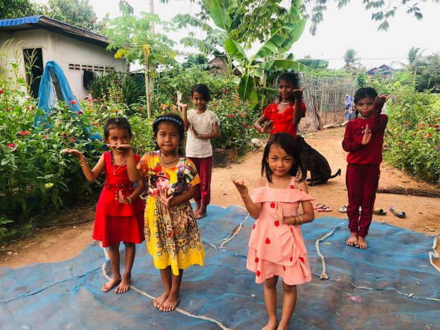 children in cambodia dancing at the Sreymao association smiling