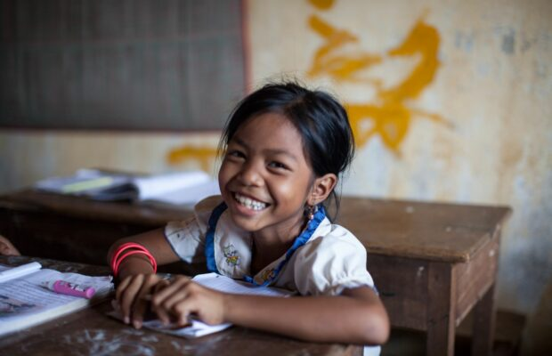 Child studying and smiling