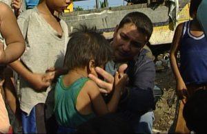 Joe Dean helping a child