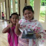 Karen state citizen holding solar panel and smiling