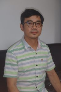 Mr Uy Vietnamese psychologist looking at the camera