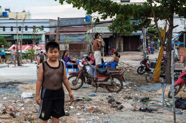 Vietnamese chid in the street looking at the camera