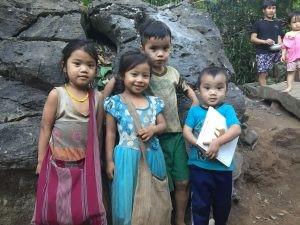 four Karen children, smiling in Mae La Oon camp,